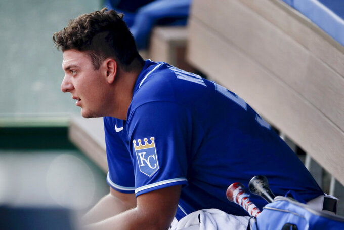 Kansas City Royals pitcher Brad Keller watches from the dugout during baseball practice at Kauffman Stadium Friday, July 3, 2020 in Kansas City, Mo. (AP Photo/Charlie Riedel)