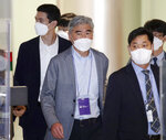 U.S. Special Representative for North Korea Sung Kim, center, arrives at Incheon International Airport in Incheon, South Korea, Saturday, June 19, 2021. Sung Kim arrived in South Korea on Saturday for talks over stalled nuclear diplomacy with the North. (Im Heon-jung/Yonhap via AP)