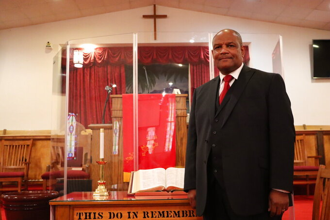 This Jan. 2, 2021 photo shows The Rev. Danny Webb, pastor at Old Mount Zion Baptist Church for 13 years in South Carolina.  Webb is continuing the legacy of the 160-year-old church first pastored by the Rev. Ned Starks when it was founded in 1861. (Damian Dominguez/The Index-Journal via AP)