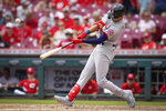 St. Louis Cardinals' Dylan Carlson hits a home run during the fourth inning of a baseball game against the Cincinnati Reds in Cincinnati, Sunday, July 25, 2021. (AP Photo/Bryan Woolston)