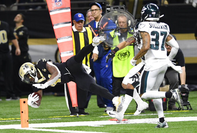 New Orleans Saints running back Alvin Kamara (41) carries to the one yard line as Philadelphia Eagles defensive back Tre Sullivan (37) pursues in the second half of an NFL divisional playoff football game in New Orleans, Sunday, Jan. 13, 2019. (AP Photo/Bill Feig)