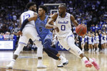 Seton Hall's Quincy McKnight (0) drives around Villanova's Justin Moore (5) during the second half of an NCAA college basketball game Wednesday, March 4, 2020, in Newark, N.J. (AP Photo/John Minchillo)