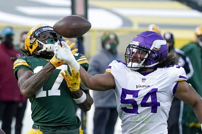 FILE - In this Sunday, Nov. 1, 2020 file photo, Minnesota Vikings' Eric Kendricks breaks up a pass intended for Green Bay Packers' Davante Adams during the second half of an NFL football game in Green Bay, Wis. Eric Kendricks and the Minnesota Vikings have had a rough year between the lines, but the 2019 All-Pro linebacker, whose 2020 season has been shortened by a calf injury, has made quite an impact off the field. He's the team's nominee for the Walter Payton Man of the Year award, for his community work focused on criminal justice reform.  (AP Photo/Morry Gash, File)