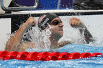 Caeleb Dressel, of the United States, celebrates winning the gold medal the men's 50-meter freestyle final at the 2020 Summer Olympics, Sunday, Aug. 1, 2021, in Tokyo, Japan.(AP Photo/Gregory Bull)