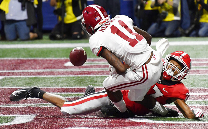 Georgia defensive back Eric Stokes (27) breaks up a catch in the end zone intended for Alabama wide receiver Henry Ruggs III (11) during the first half of the Southeastern Conference championship NCAA college football game, Saturday, Dec. 1, 2018, in Atlanta. (AP Photo/John Amis)