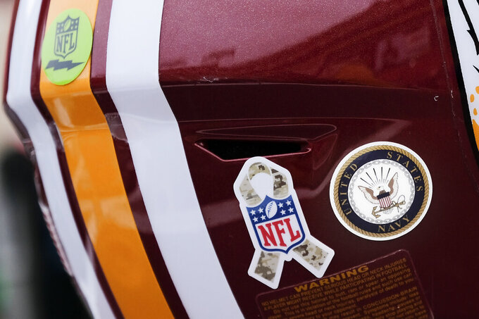A Washington Redskins football helmet sits on the turf ahead of the first half of an NFL football game between New York Jets and Washington Redskins, Sunday, Nov. 17, 2019, in Landover, Md. (AP Photo/Mark Tenally)