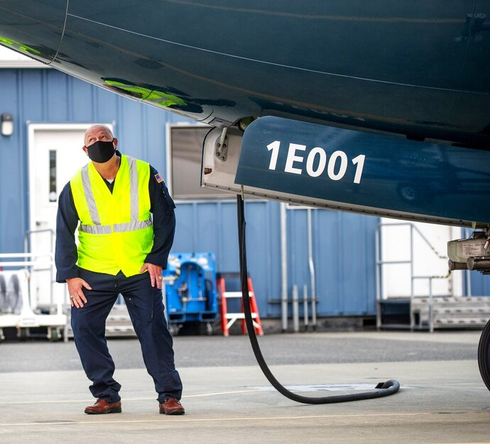 FAA chief Steve Dickson walks around a Boeing 737 MAX, conducting a pre-flight check ahead of take-off from Boeing Field in Seattle on Wednesday, Sept. 30, 2020.  Dickson, a pilot who flew for the military and Delta Air Lines, was expected to sit in the captain's seat during a two-hour flight.   The Max has been grounded since March 2019, after the second crash. (Mike Siegel/The Seattle Times via AP, Pool)