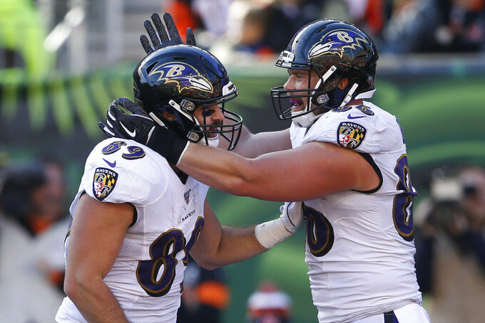 Baltimore Ravens tight end Mark Andrews (89) Cele rates his touchdown with tight end Nick Boyle (86) during the first half of NFL football game against the Cincinnati Bengals, Sunday, Nov. 10, 2019, in Cincinnati. (AP Photo/Gary Landers)
