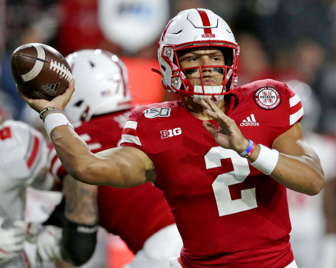 FILE - In this Sept. 28, 2019, file photo, Nebraska quarterback Adrian Martinez (2) throws a pass during the first half of an NCAA college football game against Ohio State in Lincoln, Neb. Third-year starting quarterback Martinez will be looking to bounce back after an injury-plagued season. (AP Photo/Nati Harnik, File)