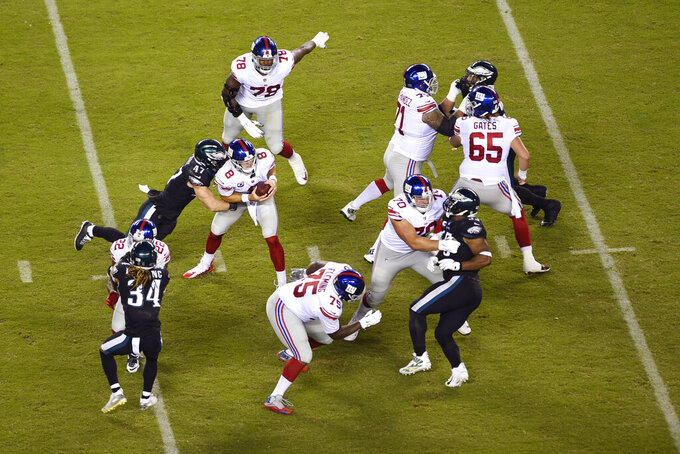 New York Giants' Daniel Jones (8) is sacked by Philadelphia Eagles' Nathan Gerry (47) during the second half of an NFL football game, Thursday, Oct. 22, 2020, in Philadelphia. (AP Photo/Derik Hamilton)
