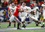 Georgia defensive back J.R. Reed (20) chases Alabama wide receiver Jerry Jeudy (4) during the second half of the Southeastern Conference championship NCAA college football game, Saturday, Dec. 1, 2018, in Atlanta. (AP Photo/John Bazemore)