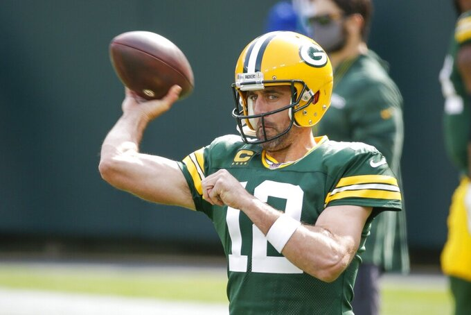 Green Bay Packers' Aaron Rodgers warms up before an NFL football game against the Detroit Lions Sunday, Sept. 20, 2020, in Green Bay, Wis. (AP Photo/Mike Roemer)
