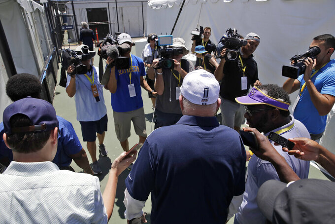 "Dallas Cowboys owner Jerry Jones is trailed by cameras as he leaves the ""state of the team"" press conference at the start of the Dallas Cowboys NFL football training camp Friday, July 26, 2019, in Oxnard, Calif. (AP Photo/Marcio Jose Sanchez)"