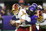 Washington Redskins quarterback Case Keenum (8) is sacked by Minnesota Vikings defensive tackle Linval Joseph during the first half of an NFL football game, Thursday, Oct. 24, 2019, in Minneapolis. (AP Photo/Jim Mone)