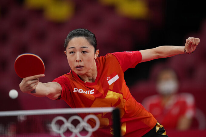 Singapore's Yu Mengyu competes during the table tennis women's singles third round match against Taiwan's Cheng I-ching at the 2020 Summer Olympics, Tuesday, July 27, 2021, in Tokyo. (AP Photo/Kin Cheung)