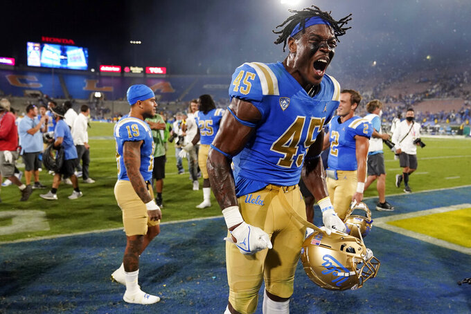 UCLA linebacker Mitchell Agude (45) celebrates the team's win over LSU in an NCAA college football game Saturday, Sept. 4, 2021, in Pasadena, Calif. (AP Photo/Marcio Jose Sanchez)