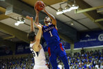 Kansas guard Devon Dotson (1) shoots over BYU forward Dalton Nixon (33) during the first half of an NCAA college basketball game, Tuesday, Nov. 26, 2019, in Lahaina, Hawaii. (AP Photo/Marco Garcia)