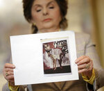 Attorney Gloria Allred holds up a picture of Latresa Scaff, left, and Rochelle Washington, posing in front of a picture of R. Kelly, on the night they claim they became victims of his sexual advances during a news conference in New York, Thursday, Feb. 21, 2019. Scaff and Washington are accusing musician R. Kelly of sexual misconduct on the night they attended a concert of his while they were teenagers.(AP Photo/Seth Wenig)