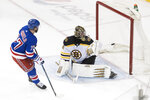 New York Rangers defenseman Tony DeAngelo (77) scores past Boston Bruins goaltender Jaroslav Halak during the shootout in an NHL hockey game Wednesday, Feb. 6, 2019, at Madison Square Garden in New York. The Rangers won 4-3. (AP Photo/Mary Altaffer)