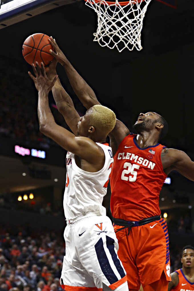 Clemson forward Aamir Simms (25) blocks a shot by Virginia forward Mamadi Diakite (25) during an NCAA college basketball game Wednesday, Feb. 5, 2020, in Charlottesville, Va. (Erin Edgerton/The Daily Progress via AP)