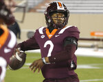 Virginia Tech's Hendon Hooker warms up for the team's NCAA college football game against Clemson on Saturday, Dec. 5, 2020, in Blacksburg, Va. (Matt Gentry/The Roanoke Times via AP, Pool)