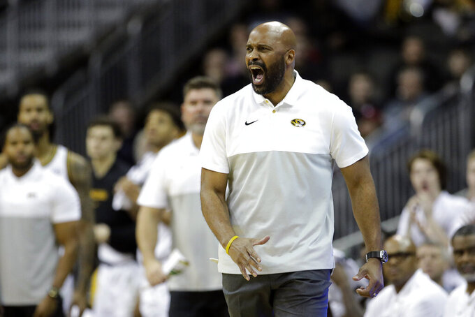 Missouri head coach Cuonzo Martin talks to his players during the first half of an NCAA college basketball game against Oklahoma, Tuesday, Nov. 26, 2019, in Kansas City, Mo. (AP Photo/Charlie Riedel)
