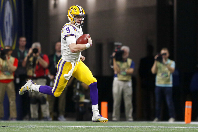 LSU quarterback Joe Burrow (9) runs against Georgia during an NCAA college football game for the Southeastern Conference championship Saturday, Dec. 7, 2019, in Atlanta, Ga. (C.B. Schmelter/Chattanooga Times Free Press via AP)