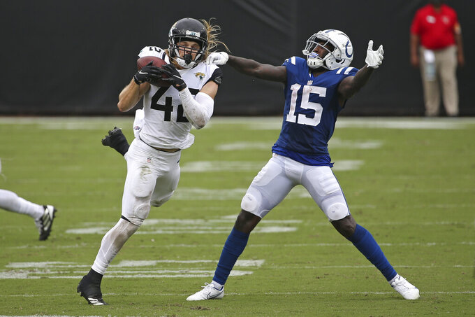 Jacksonville Jaguars safety Andrew Wingard, left, intercepts a pass in front of Indianapolis Colts wide receiver Parris Campbell (15) during the second half of an NFL football game, Sunday, Sept. 13, 2020, in Jacksonville, Fla. (AP Photo/Stephen B. Morton)