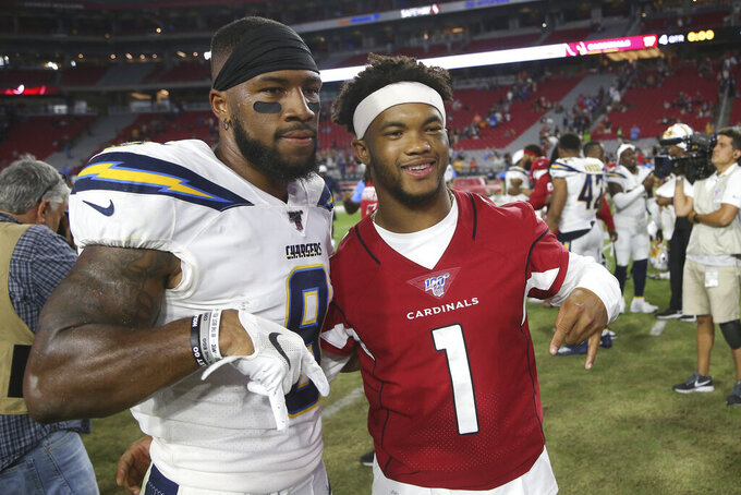 Arizona Cardinals quarterback Kyler Murray (1) and Los Angeles Chargers wide receiver Jordan Smallwood (9) pose for a photo after an NFL preseason football game, Thursday, Aug. 8, 2019, in Glendale, Ariz. (AP Photo/Ross D. Franklin)