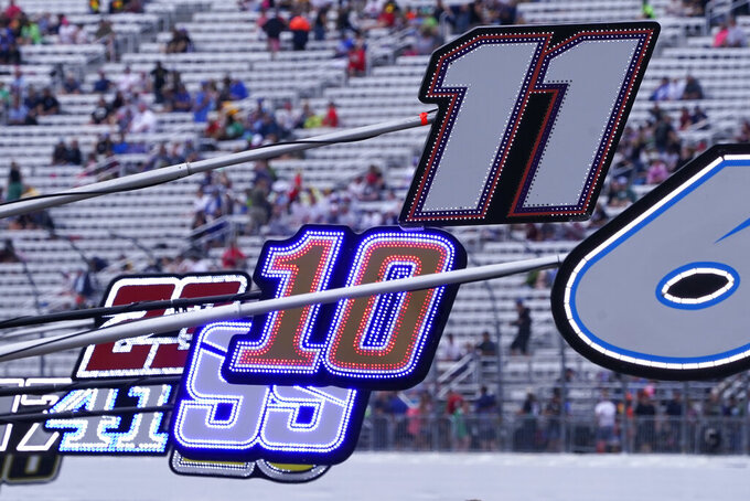 Pit stall marker numbers along pit road prior to a NASCAR Cup Series auto race, Sunday, July 18, 2021, in Loudon, N.H. (AP Photo/Charles Krupa)