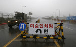 A South Korean military vehicle crosses Unification Bridge, which leads to the demilitarized zone, near the border village of Panmunjom in Paju, South Korea, Wednesday, May 16, 2018. North Korea on Wednesday canceled a high-level meeting with South Korea and threatened to scrap a historic summit next month between U.S. President Donald Trump and North Korean leader Kim Jong Un over military exercises between Seoul and Washington that Pyongyang has long claimed are invasion rehearsals. The barricade reads:
