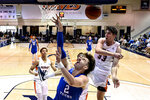 Pepperdine guard Skylar Chavez (33) blocks a shot by BYU guard Zac Seljaas (2) during the first half of an NCAA college basketball game Saturday, Feb. 29, 2020, in Malibu, Calif. (AP Photo/Ringo H.W. Chiu)