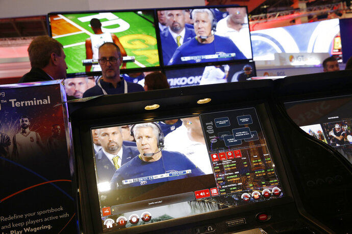 The CrystalBetting sports betting terminal is on display at the IGT booth during the Global Gaming Expo, Wednesday, Oct. 10, 2018, in Las Vegas. (AP Photo/John Locher)