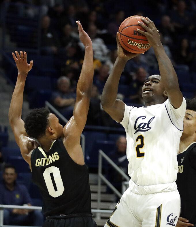 California's Juhwan Harris-Dyson, right, shoots as Colorado's Shane Gatling defends during the first half of an NCAA college basketball game Thursday, Jan. 24, 2019, in Berkeley, Calif. (AP Photo/Ben Margot)