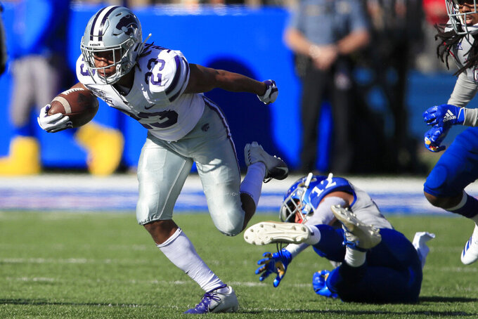 Thompson runs for 3 TDs as No. 22 K-State routs Kansas 38-10