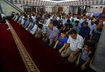 Muslim worshippers attend evening prayers at Abdul-Qadir al-Gailani mosque in Baghdad, Iraq, Wednesday, May 16, 2018. Muslims throughout the world are preparing to celebrate Ramadan, the holiest month in the Islamic calendar, refraining from eating, drinking, smoking and sex from sunrise to sunset. (AP Photo/Karim Kadim)