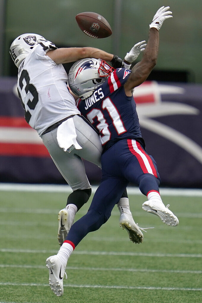 New England Patriots defensive back Jonathan Jones (31) breaks up a pass intended for Las Vegas Raiders wide receiver Hunter Renfrow (13) in the second half of an NFL football game, Sunday, Sept. 27, 2020, in Foxborough, Mass. (AP Photo/Charles Krupa)