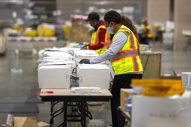 Workers are shown during a media tour highlighting the preparations for the sorting and counting of mail-in ballots at the Pennsylvania Convention Center for Election Day in Philadelphia, Monday, Oct. 26, 2020. (Jose F. Moreno/The Philadelphia Inquirer via AP)