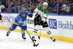 FILE - In this Feb. 8, 2020, file photo, Dallas Stars' Miro Heiskanen (4), of Finland, passes around St. Louis Blues' Jaden Schwartz (17) during the second period of an NHL hockey game in St. Louis. This is a Stanley Cup matchup for all of those who like their games to be a bit defensive. The Stars and the Tampa Bay Lightning, two of the league's southernmost teams playing for the title in a bubble at the NHL's most northern arena in Edmonton, both have defensemen who provide plenty of points. (AP Photo/Jeff Roberson, File)