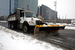 Snow is cleared off of Vine Street in Downtown Cincinnati on Monday, Feb. 15, 2021. The National Weather Service issued a winter storm warning starting Monday and going through  Tuesday with heavy snow expected. (Albert Cesare /The Cincinnati Enquirer via AP)