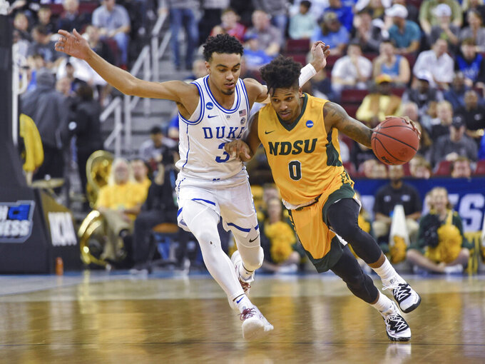 North Dakota State's Vinnie Shahid (0) drives against Duke's Tre Jones (3) during the first half of a first-round game in the NCAA men's college basketball tournament in Columbia, S.C. Friday, March 22, 2019. (AP Photo/Richard Shiro)