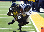 Missouri running back Damarea Crockett, left, is tackled just short of the goal line by Vanderbilt's Kenny Hebert, right, during the second half of an NCAA college football game Saturday, Nov. 10, 2018, in Columbia, Mo. (AP Photo/L.G. Patterson)