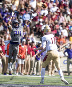 James Madison safety D'Angelo Amos (24) leaps up to try to block a pass from Elon quarterback Davis Cheek (17) during the first half of an NCAA college football game in Harrisonburg, Va., Saturday, Oct. 6, 2018. (Daniel Lin/Daily News-Record via AP)