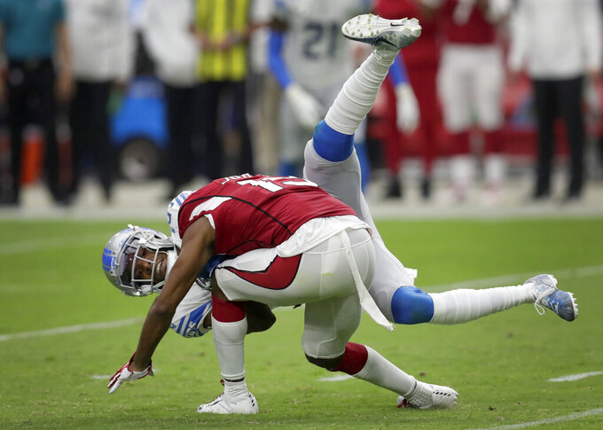 Detroit Lions cornerback Rashaan Melvin, rear, tackles Arizona Cardinals wide receiver KeeSean Johnson during the second half of an NFL football game, Sunday, Sept. 8, 2019, in Glendale, Ariz. (AP Photo/Darryl Webb)