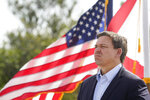 Florida Gov. Ron DeSantis listens during a news conference, Tuesday, Aug. 3, 2021, near the Shark Valley Visitor Center in Miami. DeSantis is doubling down as the state again broke its record for COVID-19 hospitalizations. The Republican governor insisted Tuesday that the spike will be short-lived. (AP Photo/Wilfredo Lee)