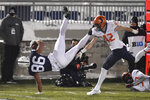 Penn State tight end Brenton Strange (86) scores a third quarter touchdown as Illinois defensive back Michael Marchese (42) defends during an NCAA college football game in State College, Pa., on Saturday, Dec. 19, 2020. (AP Photo/Barry Reeger)