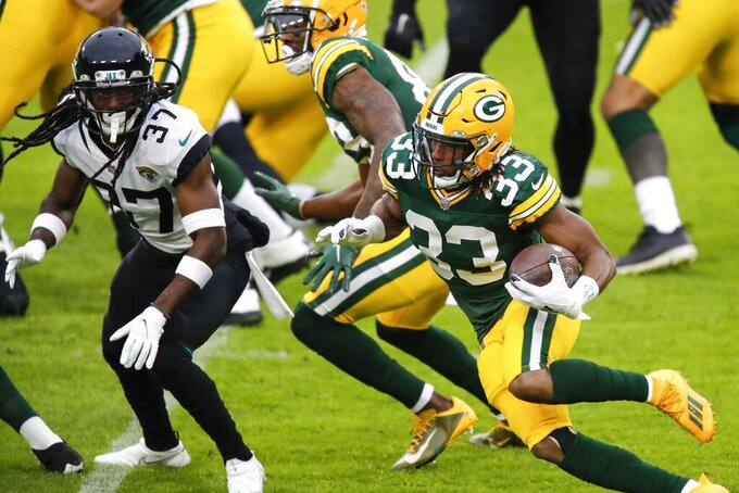 Green Bay Packers' Aaron Jones runs during the first half of an NFL football game against the Jacksonville Jaguars Sunday, Nov. 15, 2020, in Green Bay, Wis. (AP Photo/Matt Ludtke)