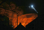 In this Sunday, Jan. 12, 2020 photo, firefighters battle a fire on East Man Street in Bound Brook, N.J. (Ed Murray/NJ Advance Media via AP)