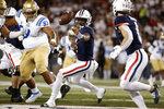 Arizona quarterback Jordan McCloud (4) tosses the ball during the first half of the team's NCAA college football game against UCLA on Saturday, Oct. 9, 2021, in Tucson, Ariz. (AP Photo/Chris Coduto)