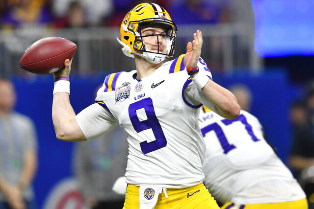 FILE - In this Dec. 28, 2019, file photo, LSU quarterback Joe Burrow (9) works against Oklahoma during the first half of the Peach Bowl NCAA semifinal college football playoff game, in Atlanta. LSU's Joe Burrow and Justin Jefferson were easy selections for The Associated Press all-bowl team. The two connected for four first-half touchdowns in a College Football Playoff semifinal blowout of Oklahoma.  (AP Photo/John Amis, File)